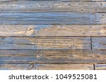 weathered wooden footpath with...   Shutterstock . vector #1049525081