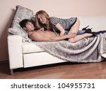Loving couple in the bedroom. - stock photo