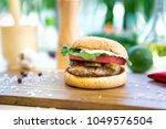 appetizing hamburger on wooden...   Shutterstock . vector #1049576504
