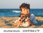 happy 8 year old boy hugging... | Shutterstock . vector #1049586179