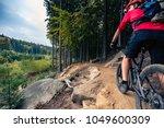 mountain biker riding on bike... | Shutterstock . vector #1049600309