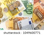 money euro coins and banknotes | Shutterstock . vector #1049600771