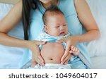 close up hands of mother... | Shutterstock . vector #1049604017