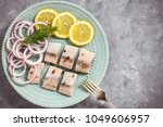 Stock photo pickled herring with red onion and lemon slices 1049606957