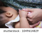 mother   s hand catch baby with ... | Shutterstock . vector #1049614829
