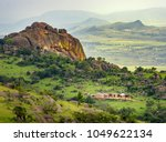 Small photo of Ezulwini valley in Swaziland eSwatini with beautiful mountains, trees and rocks in scenic green valley between Mbabane and Manzini cities. Traditional huts houses of Swaziland