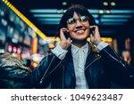 cheerful brunette female... | Shutterstock . vector #1049623487