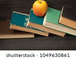 stack of old books  wooden... | Shutterstock . vector #1049630861