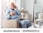 making plans. pleasant elderly...   Shutterstock . vector #1049632511