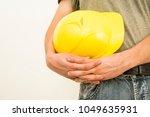 construction worker hands... | Shutterstock . vector #1049635931