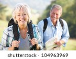 senior couple on country walk | Shutterstock . vector #104963969