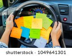 two hands holding driving wheel ... | Shutterstock . vector #1049641301