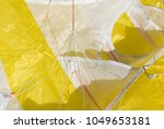 Small photo of kite used to make snowkite in snow, waiting to take off, detail of cables or ropes, in dacron, yellow kite fabric, high mountains, extreme sport, Alps, Devero Valley, Piedmont, Italy