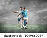 soccer players on a football... | Shutterstock . vector #1049660039