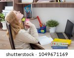 girl teenager doing homework | Shutterstock . vector #1049671169