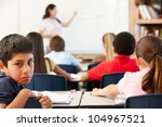 unhappy schoolboy in class | Shutterstock . vector #104967521