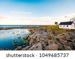 village of reine on lofoten... | Shutterstock . vector #1049685737