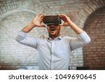 man have fun with virtual... | Shutterstock . vector #1049690645