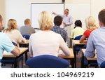 senior tutor teaching class   Shutterstock . vector #104969219