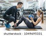 sporty couple exercising... | Shutterstock . vector #1049695331