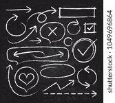hand drawn white chalk arrows ... | Shutterstock .eps vector #1049696864