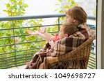 happy grandmother with her... | Shutterstock . vector #1049698727