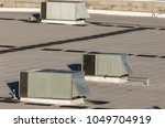 air conditioning units on top...   Shutterstock . vector #1049704919