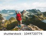 traveler woman raised hands... | Shutterstock . vector #1049720774