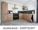 a modern wooden look kitchen in ... | Shutterstock . vector #1049721347
