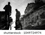 blurry reflection silhouette of ... | Shutterstock . vector #1049724974