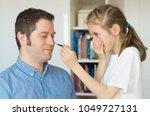 cute little girl making makeup...   Shutterstock . vector #1049727131