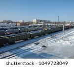 lot of cargo trains at station. ... | Shutterstock . vector #1049728049