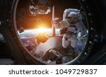 astronaut in space working on a ... | Shutterstock . vector #1049729837