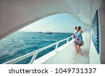 happy young couple having beach ... | Shutterstock . vector #1049731337