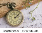 pocket watch and book on white... | Shutterstock . vector #1049733281