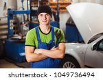 a young man posing with a... | Shutterstock . vector #1049736494