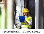 young female engineer using... | Shutterstock . vector #1049753969