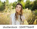 young woman boho style portrait ...   Shutterstock . vector #1049776649