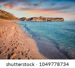 footprints in the sand on the... | Shutterstock . vector #1049778734