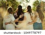 four boho style women from... | Shutterstock . vector #1049778797