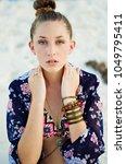 teenager boho style on beach   Shutterstock . vector #1049795411