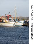 Small photo of traditional Greek fishing boats in harbor Adamas Milos Cyclades Greek island Greece