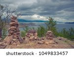 pyramids of stones on the... | Shutterstock . vector #1049833457