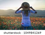 woman with straw hat is...