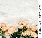 pastel tea rose flowers on... | Shutterstock . vector #1049854211