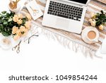 female workspace with laptop ... | Shutterstock . vector #1049854244
