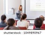 female speaker giving... | Shutterstock . vector #1049890967