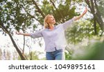 happy woman in spring or summer ... | Shutterstock . vector #1049895161