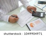 data analyst analyzing business ... | Shutterstock . vector #1049904971