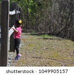 little girl playing outdoors at ... | Shutterstock . vector #1049905157